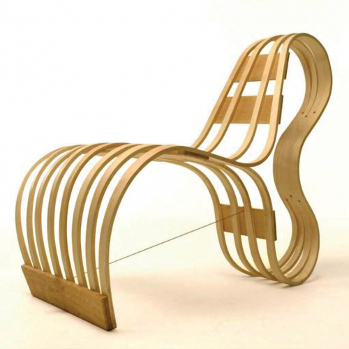 Steam bent wood curved lounger chair by Tom Raffield