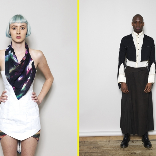 Female model with blue bobbed hair in white minidress and patterned scarf and male model in white shirt, black caped jacket and long skirt.