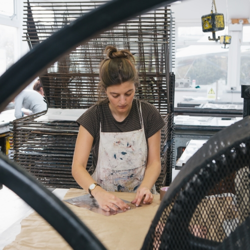 Female student in printmaking studio